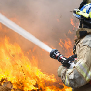 A career firefighter putting out a fire