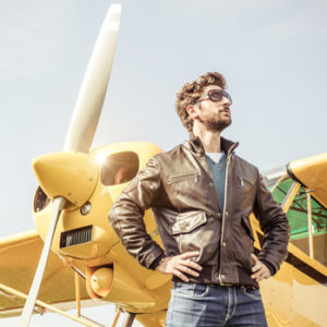 A pilot with his airplane.